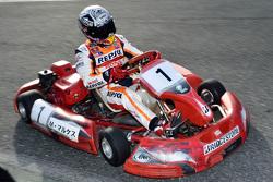 Marc Marquez drives a kart