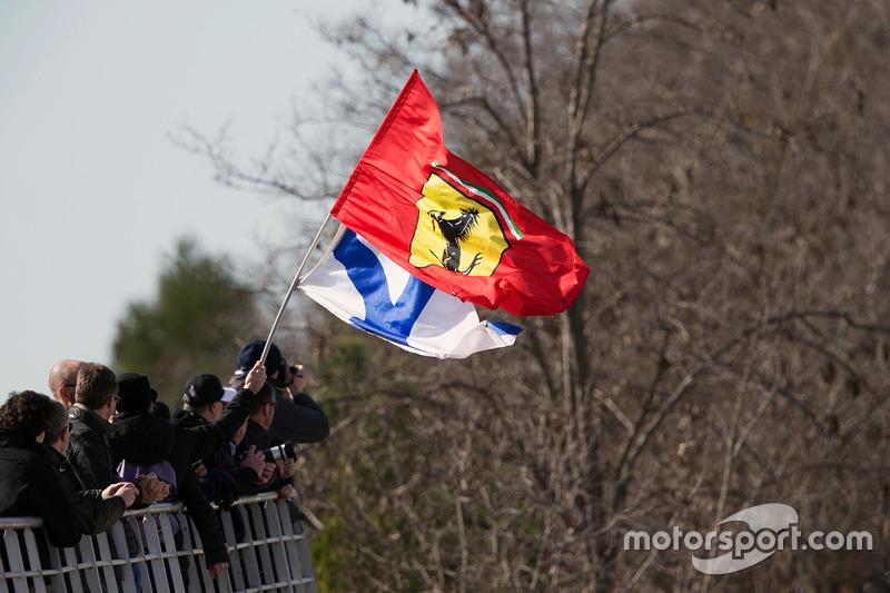 Kimi Raikkonen, Ferrari fans with flags