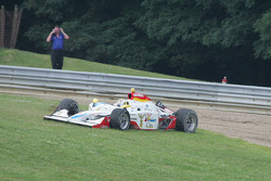 Mario Dominguez's collapsed wing causes him to spin into the gravel pit in corner 4