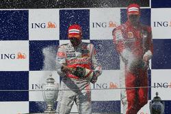 Podium: race winner Heikki Kovalainen, third place Kimi Raikkonen