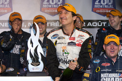 Victory lane: race winner Ron Fellows celebrates with champagne