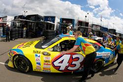 Cheerios Dodge crew members push the #43 car to the garage