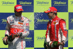 Podium: race winner Felipe Massa and second place Lewis Hamilton celebrate with champagne
