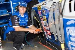 A Fastenal crew member checks the tire pressure