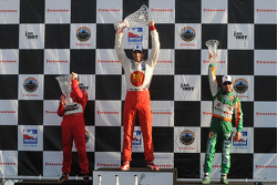 Podium: race winner Justin Wilson, second place Helio Castroneves and third place Tony Kanaan