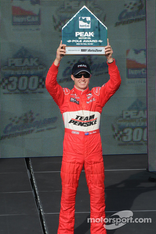 Ryan Briscoe raises his Pole Award in triumph