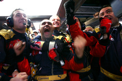Scuderia Toro Rosso mechanics celebrate the pole position of Sebastian Vettel