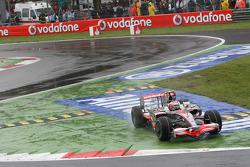 Heikki Kovalainen, McLaren Mercedes, MP4-23 cuts the chicane
