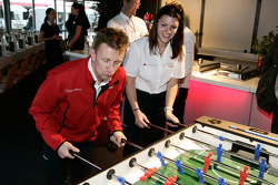 Allan McNish and Katherine Legge play fussball at the Audi Sport Team Joest hospitality