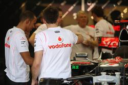 Lewis Hamilton, McLaren Mercedes with team members in the garage