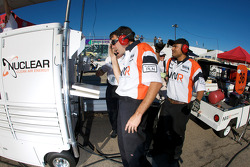 Newman Wachs Racing team members watch qualifying as Jonathan Summerton sets the fastest time