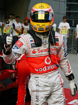 Pole winner Lewis Hamilton celebrates
