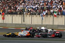 Fernando Alonso, Renault F1 Team, R28 leads Heikki Kovalainen, McLaren Mercedes, MP4-23