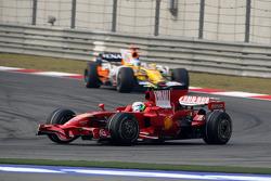 Felipe Massa, Scuderia Ferrari, F2008 leads Fernando Alonso, Renault F1 Team, R28