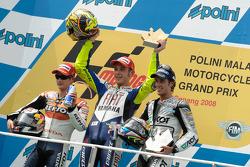 Podium: race winner Valentino Rossi, second place Dani Pedrosa, third place Andrea Dovizioso