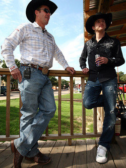 Former four-time bull riding champion Tuff Hedeman (left) visits with NASCAR Sprint Cup Series driver Scott Speed (right) before giving him some tips for his mechanical bull ride in the Fort Worth Stockyards