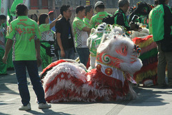 The lion dance to bring luck