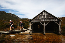 Launceston, Australia: competitors run past the boat shed on their way to Cradle Mountain