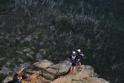 Launceston, Australia: competitors look over the edge from the summit of Cradle Mountain
