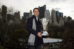 Jimmie Johnson poses with the NASCAR Sprint Cup Series trophy in Central Park in front of the New York City skyline