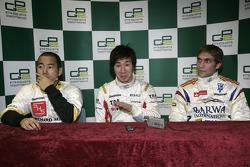 Kamui Kobayashi celebrates his pole position with Sakon Yamamoto and Vitaly Petrov