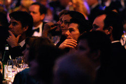 Actor Tom Cruise watches the NASCAR Sprint Cup Series Awards Ceremony while sitting at Jeff Gordon's table at the Waldorf=Astoria