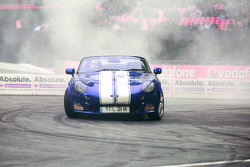 Terry Grant entertains the crowd with some doughnuts in his TVR
