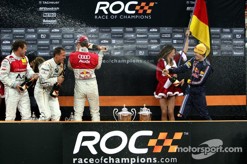 Podium: Michael Schumacher, Sebastian Vettel, Mattias Ekström and Tom Kristensen spray champagne