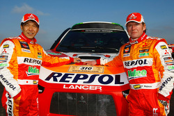 Repsol Mitsubishi Ralliart Team: driver Hiroshi Masuoka and co-driver Pascal Maimon with the #310 Mitsubishi Lancer