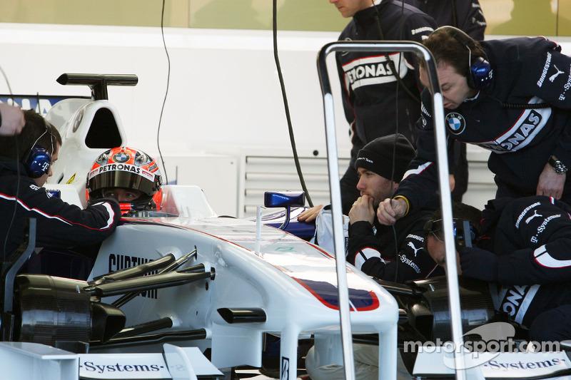 Robert Kubica, BMW Sauber F1 Team after his first installation lap, and Nick Heidfeld, BMW Sauber F1 Team