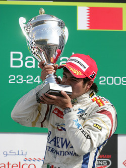 Sergio Perez celebrates winning on the podium