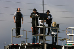 Crew members watch practice action from atop their transporter