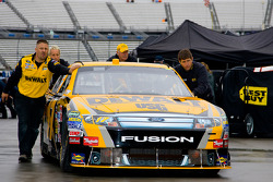 Matt Kenseth's crew push the DeWalt Ford to it's garage stall