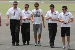 Jenson Button, Brawn GP on his walk with Ross Brawn Brawn GP Team Principal