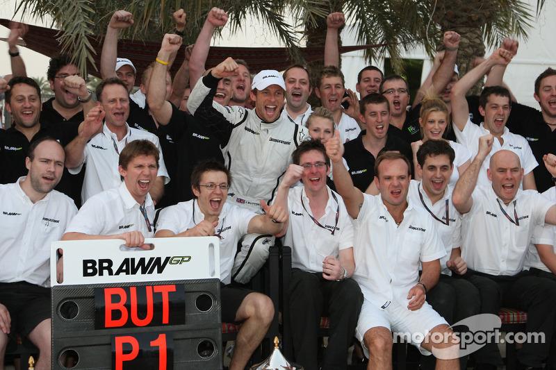 Brawn GP celebration: Jenson Button celebrates win with teammate Rubens Barrichello and Brawn GP tea