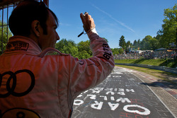Drivers parade around the track: Emanuele Pirro waves to fans