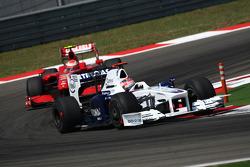 Robert Kubica, BMW Sauber F1 Team and Kimi Raikkonen, Scuderia Ferrari