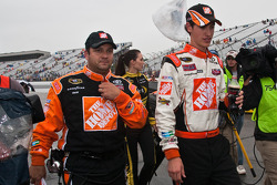 Race winner Joey Logano, Joe Gibbs Racing Toyota and crew chief Greg Zipadelli walk to victory lane