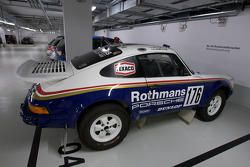In the parking: (a replica of?) the Porsche 911 of René Metge and Dominique Lemoyne that won the Dakar Rally in 1984