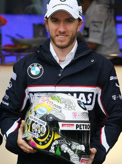 Nick Heidfeld, BMW Sauber F1 Team with a new helmet design competition winner Tamas Simon