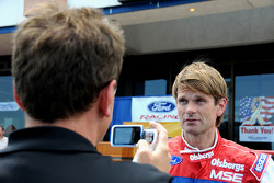Ford Fiesta driver Marcus Gronholm gives an interview to a member of the Colorado Springs press corps