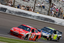 Tony Stewart, Stewart-Haas Racing Chevrolet leads Jimmie Johnson, Hendrick Motorsports Chevrolet