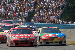 Restart: Tony Stewart, Stewart-Haas Racing Chevrolet and Kyle Busch, Joe Gibbs Racing Toyota battle
