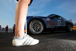 A grid girl and the #37 JBS Motorsports Ford Mustang GT: James Gue, Bret Seafuse