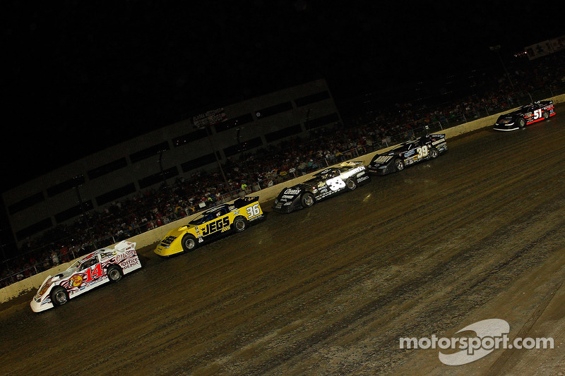 Tony Stewart, driver of the #14 leads the field near the end of