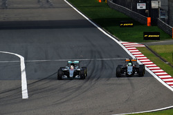Lewis Hamilton, Mercedes AMG F1 Team W07 and Nico Hulkenberg, Sahara Force India F1 VJM09 battle for position