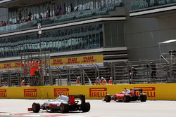 Esteban Gutierrez, Haas F1 Team VF-16 passes Sebastian Vettel, Ferrari SF16-H, who stopped on the start / finish straight