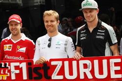 (L to R): Sebastian Vettel, Ferrari; Nico Rosberg, Mercedes AMG F1; and Nico Hulkenberg, Sahara Force India F1, promote the return of the German Grand Prix