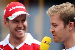 (L to R): Sebastian Vettel, Ferrari with Nico Rosberg, Mercedes AMG F1
