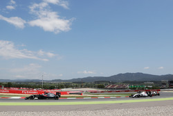Fernando Alonso, McLaren MP4-31 leads Felipe Massa, Williams FW38 and Romain Grosjean, Haas F1 Team VF-16